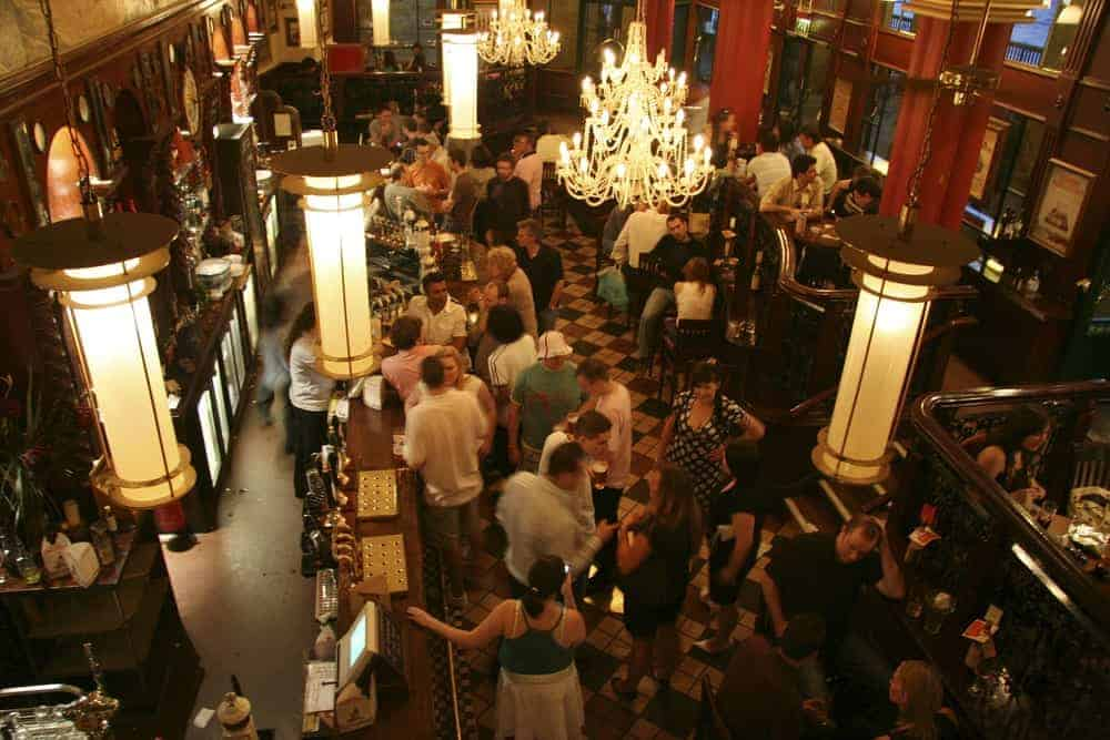 Overhead view of a bar packed with customers.