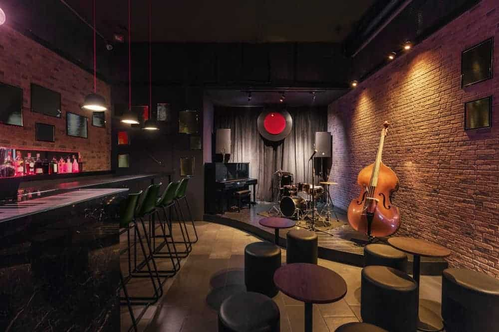 Empty jazz bar with music instruments on stage.
