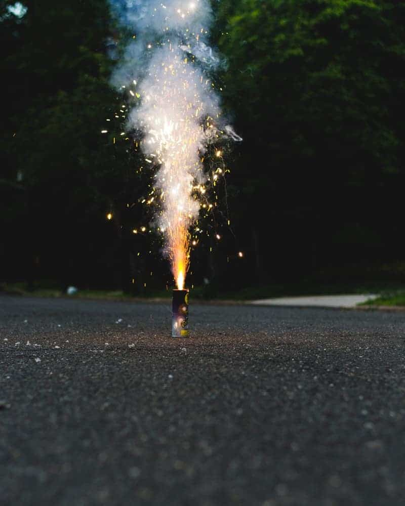A novelty fountain firework exploding on the ground.