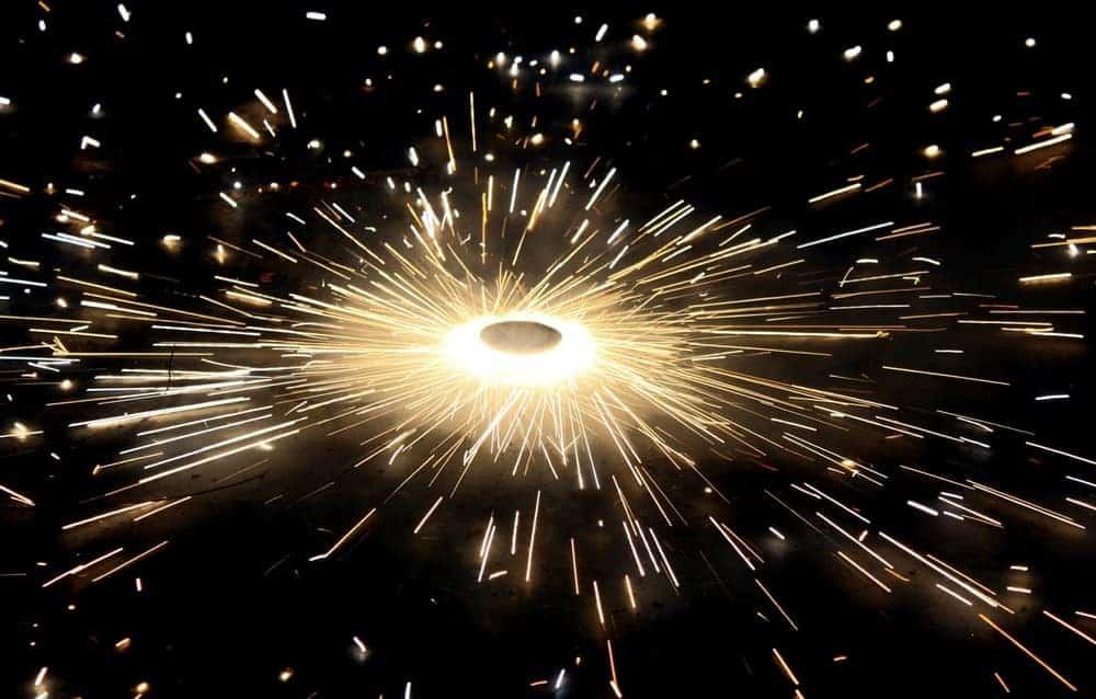 A ground spinner splashing sparks around it in a circular pattern.