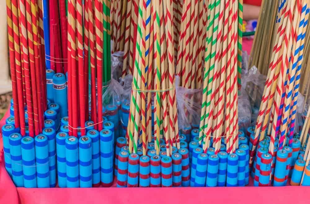 Bundles of rocket fireworks on display at a store.