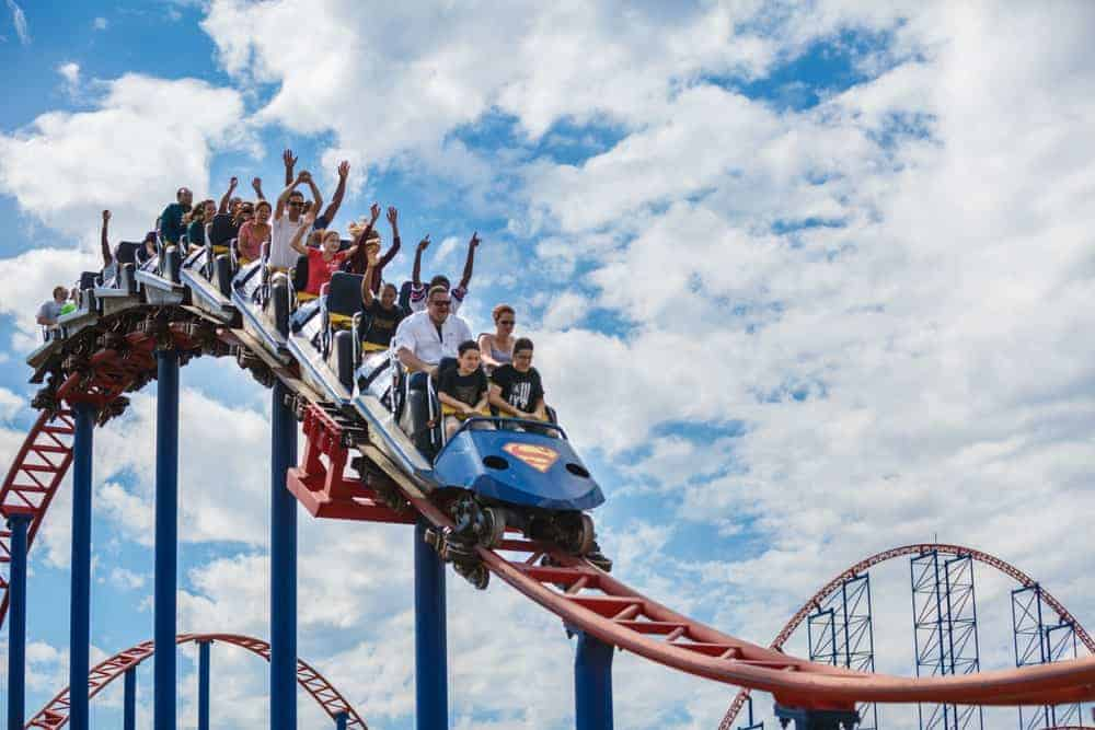 A group of people enjoying the roller coaster ride.