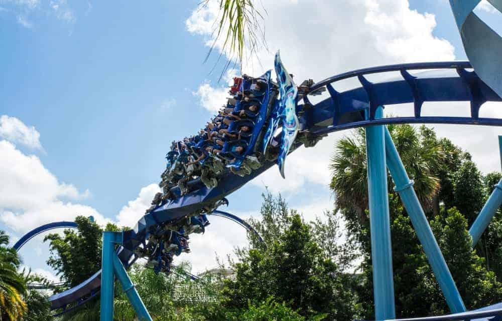 Amusement park visitors riding the Manta flying roller coaster in Orlando, Florida.