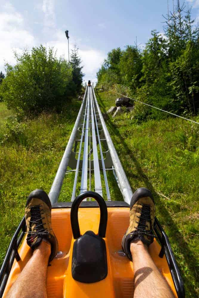 A first-person look at riding a bobsled roller coaster.