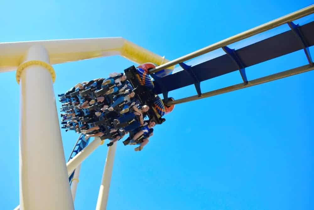Amusement park visitors riding the Montu inverted roller coaster in Tampa, Florida.
