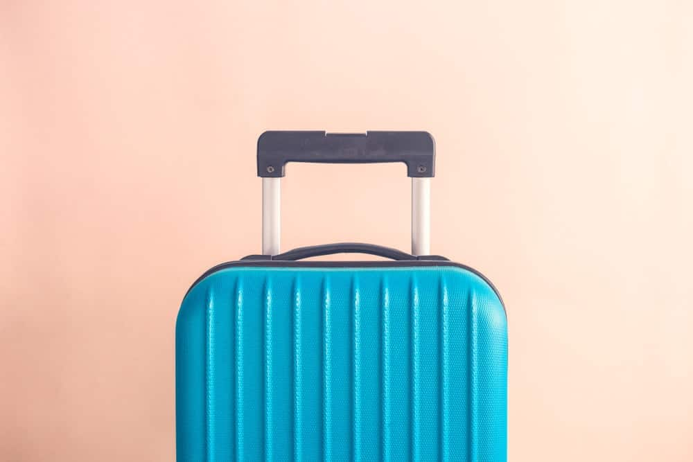 A close look at a blue hard case luggage.
