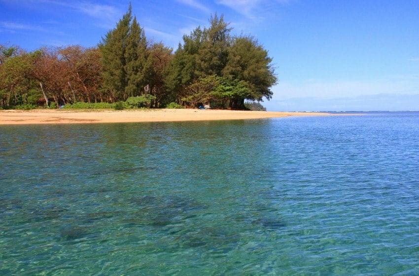 A look at the crystal clear waters of Anini Beach Kauai in Hawaii.
