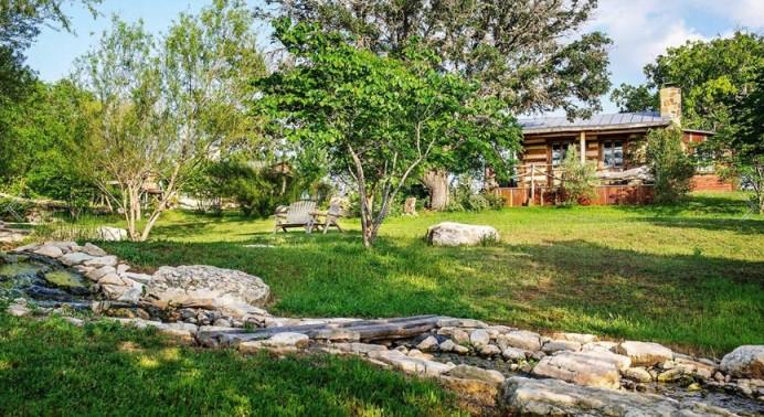 A wooden cabin inside Barons Creekside in Fredericksburg, Texas.
