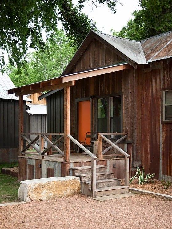 A wooden cabin inside Camp Comfort in Comfort, Texas.
