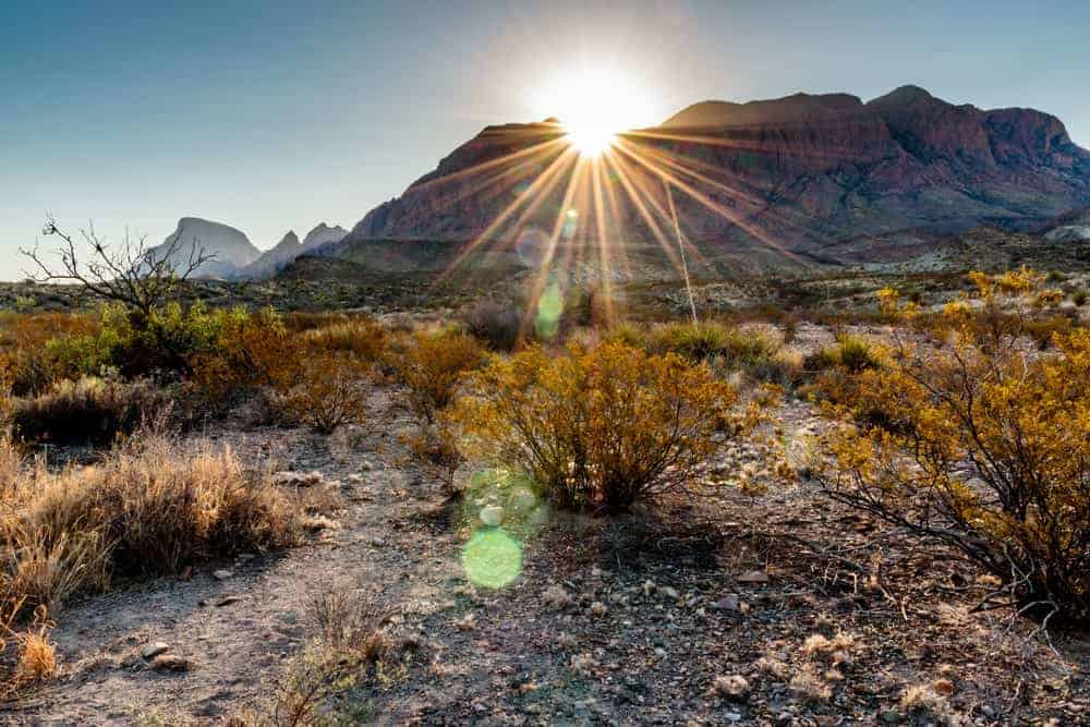 The sun rising behind the Chisos Mountains at Big Bend National Park.