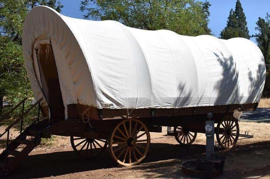 A conestoga wagon inside the Yosemite Pines RV Resort.