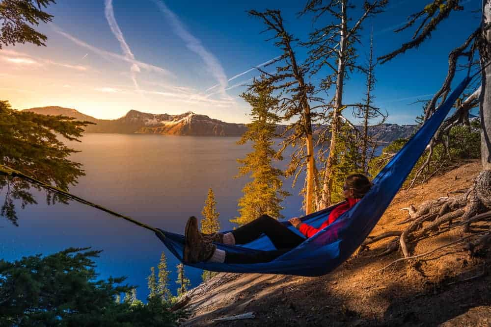 A woman relaxing on a hammock in Crater Lake National Park, Oregon.
