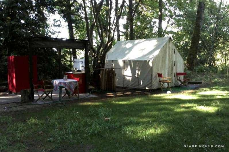 A shaded romantic rustic luxury tent in Sherwood.