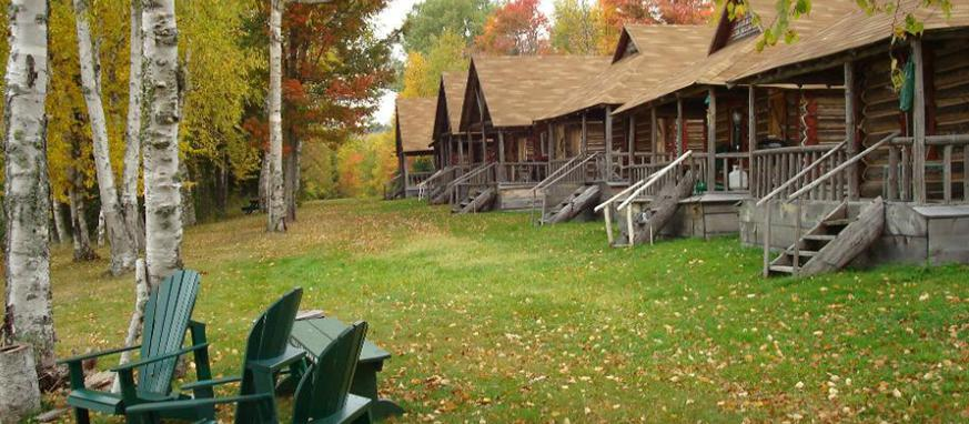 A row of wooden cabins inside Eagle Lake Sporting Camp.
