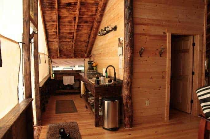 A log cabin interior inside Edenwood Ranch Preserve.