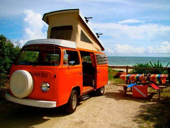 Red Classic Camper parked in a camping ground.