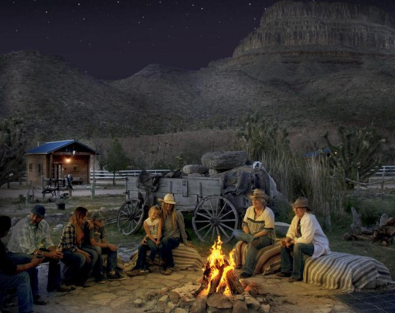 Campers sitting around a bonfire at Grand Canyon Western Ranch.