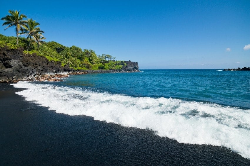 A scenery of Honokalani Black Sand Beach at Wainapanapa State Park Maui in Hawaii.