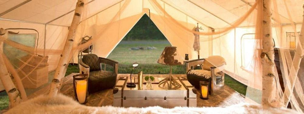 A luxurious tent interior in Sandy Pines Campground.