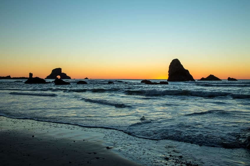 Oregon coastline with the field of rocks at sunset.