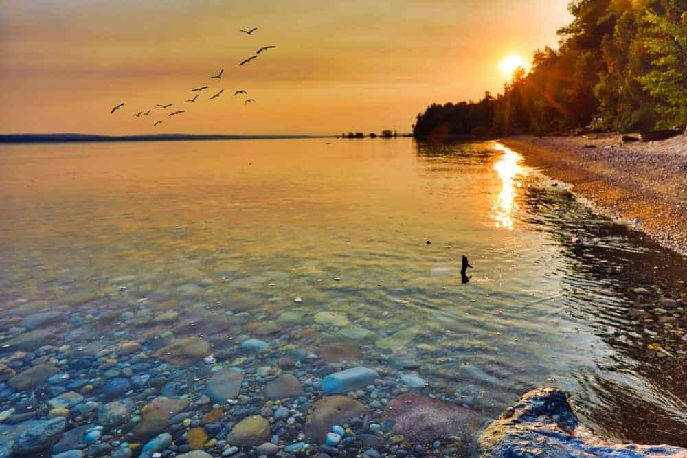 A scenic sunset view of Lake Michigan.