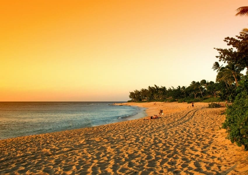 A sunset view of the North Shore Beach of Oahu.