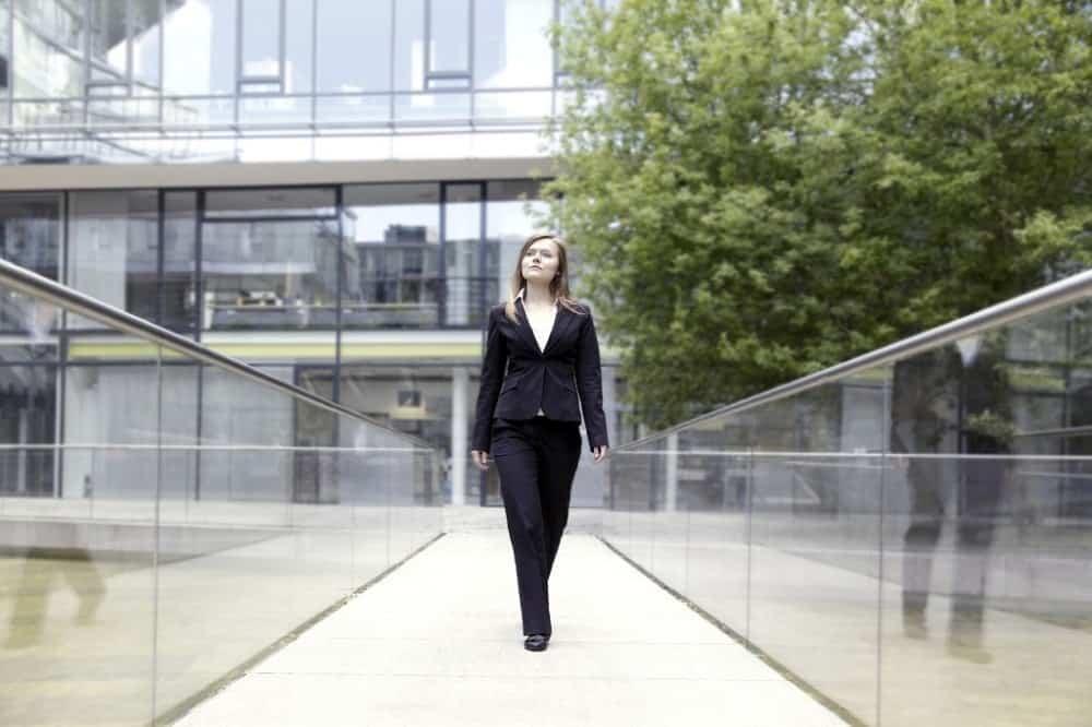 A woman walking outside enjoying some free time.