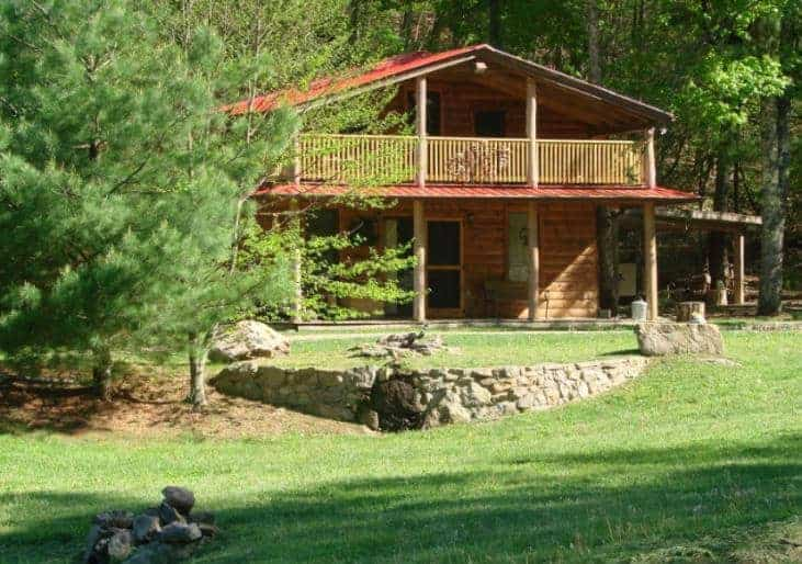 A look at the Rock-N-Creek Cabin surrounded by lush landscaping.