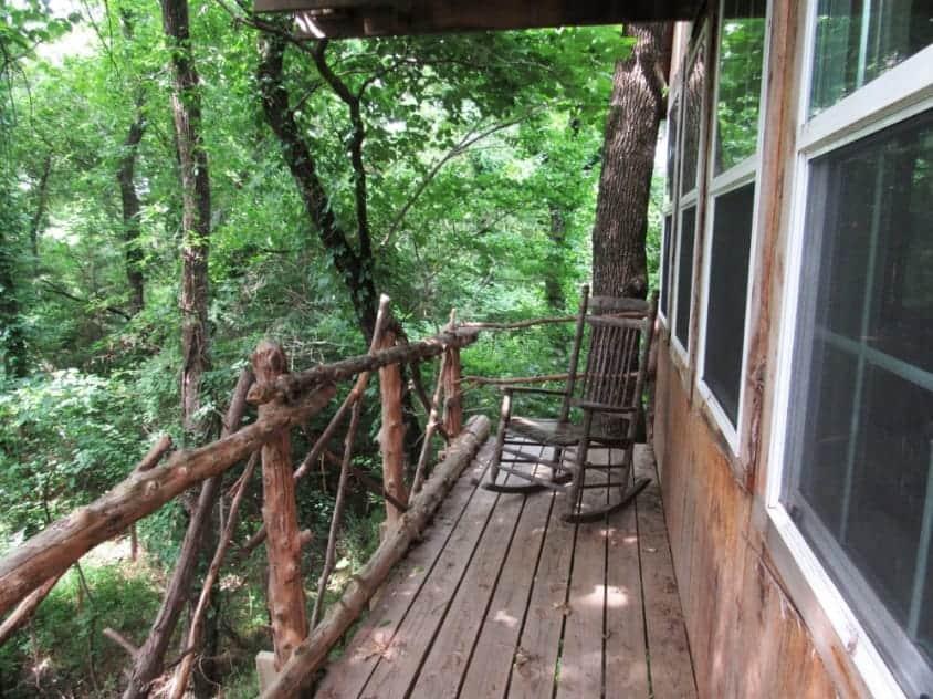 A treehouse balcony in Savannah's Meadow Tree House in Celeste, Texas.