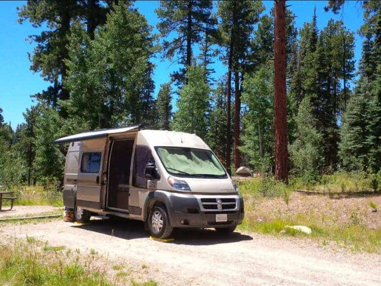 A parked RV inside the DeMotte Campgrounds.