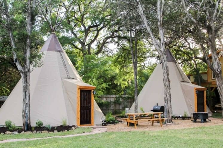 A couple of tipis on the Guadalupe in New Braunfels, Texas.