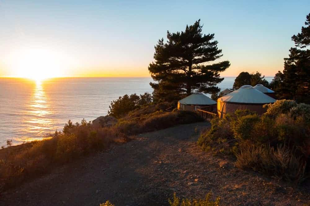 A cluster of yurts by the cliff of Paddler's Village.