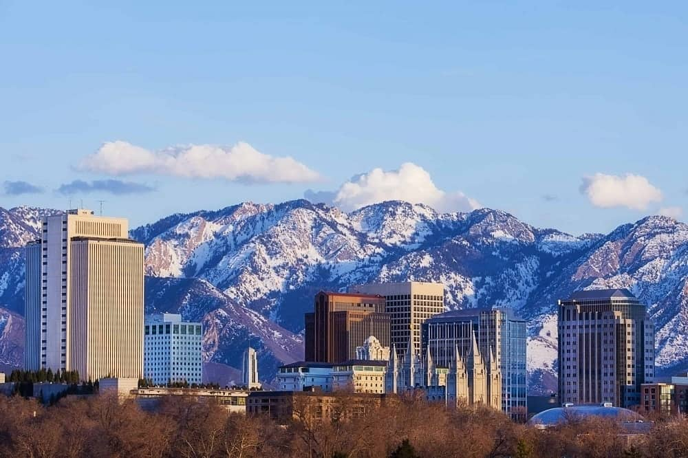 Salt Lake City skyline with Wasatch mountains as the backdrop.