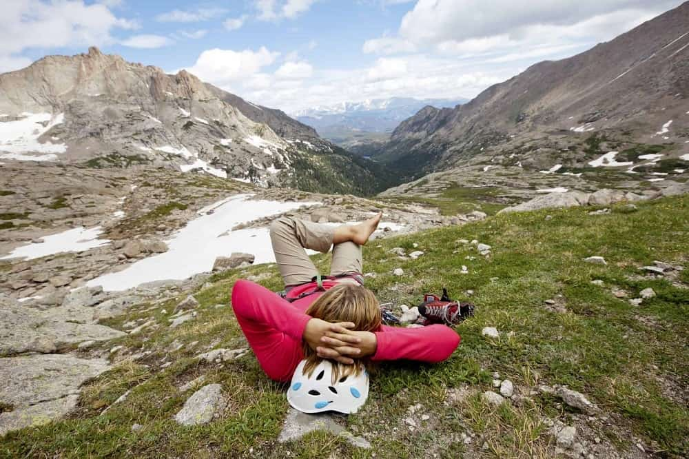 Hiker relaxing in the rocky mountains outside of Denver.