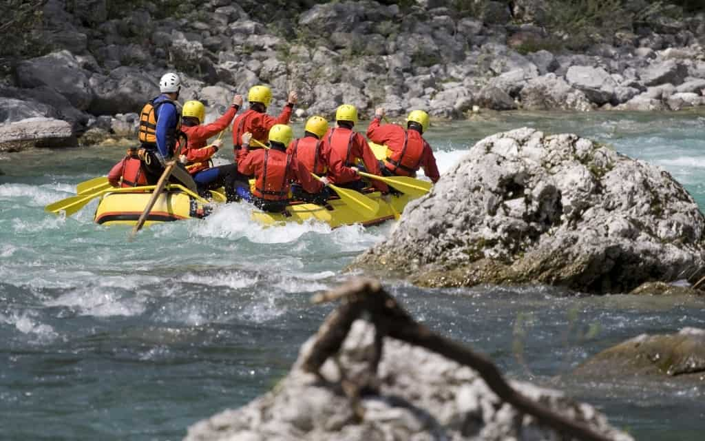 A white water rafting guide with clients.