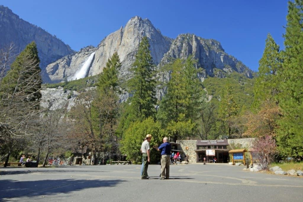 A National Park ranger helping visitor.