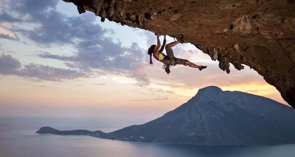 A look at a woman rock climbing.