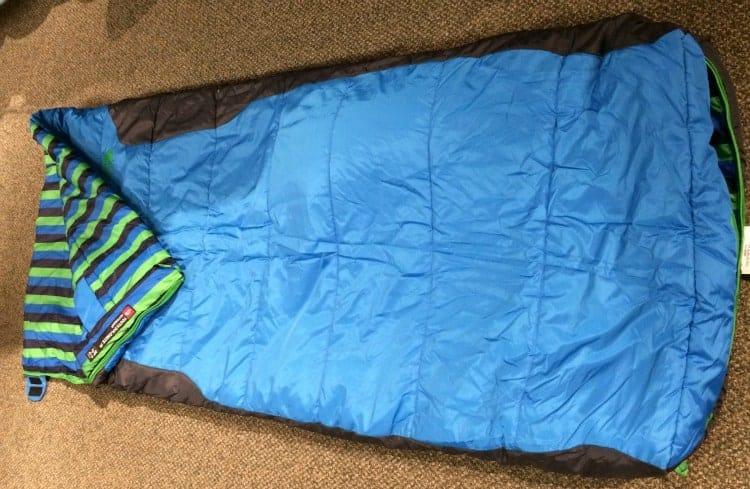 A blue North Face 3S kids sleeping bag.