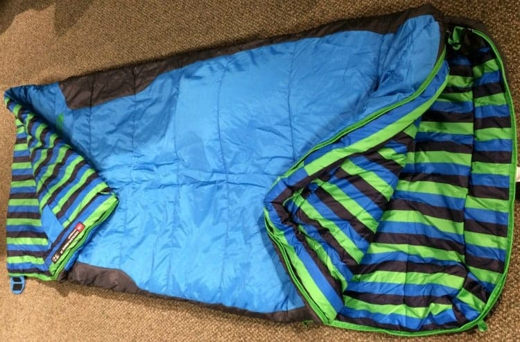 A blue North Face 3S kids sleeping bag showing the inside.