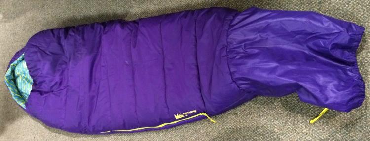 A purple REI Kindercone sleeping bag for kids.