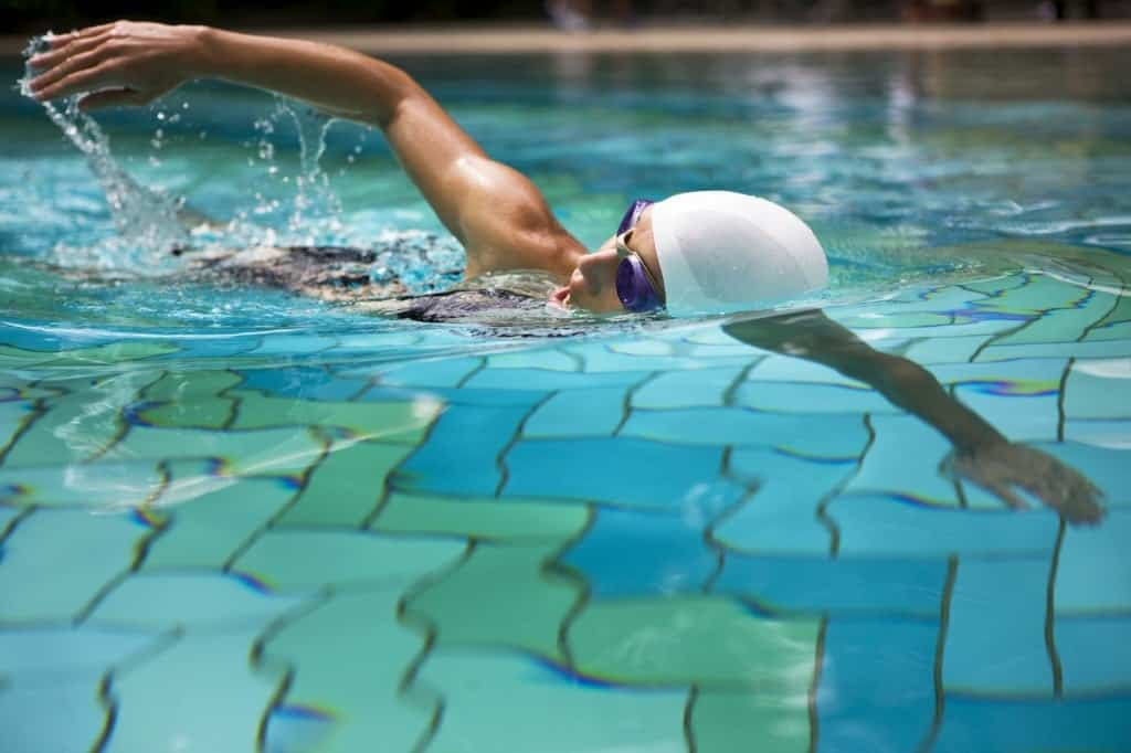 A swimmer doing laps in a pool.