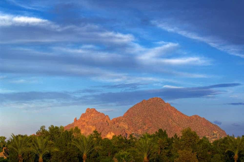 A look at the peaks of Camelback Mountain against a blue sky.