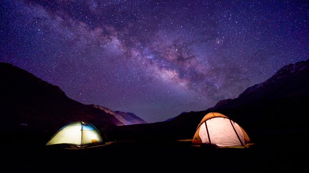 A scenic view of camping under the Milky Way.