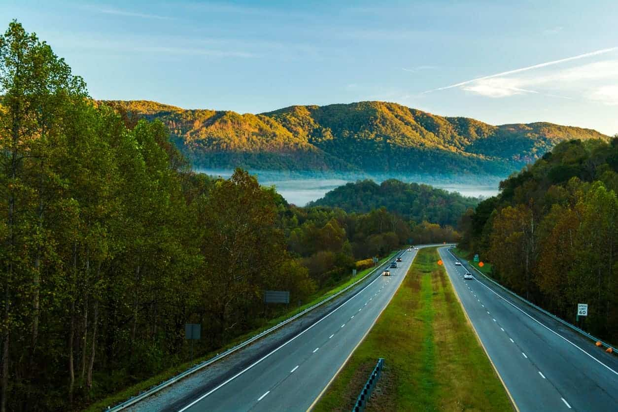 An aerial view of a road in Virginia heading to the mountains.