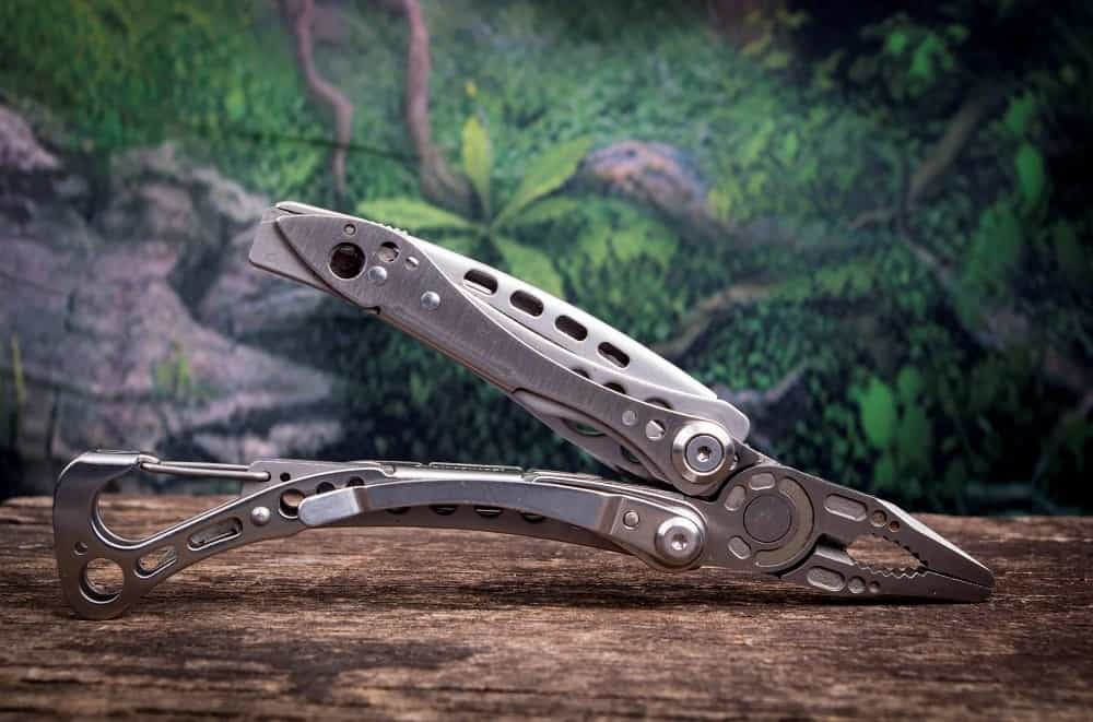 Multi purpose tool with woods in the background.