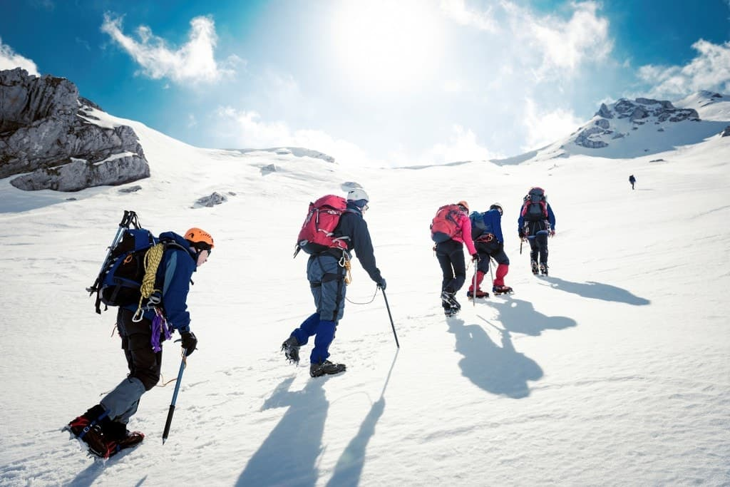 A group of climbers ascending a mountain in the Pacific Northwest.