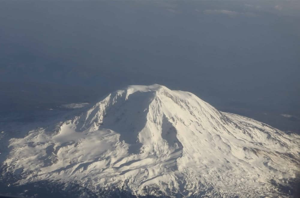 An aerial view of snow-covered Mount Adams.