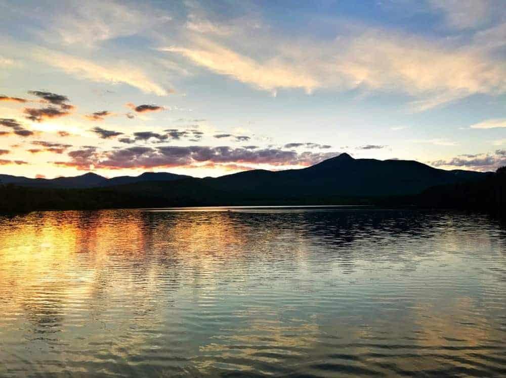 Silhouette of Mt. Chocorua across the sea while the sun rises.