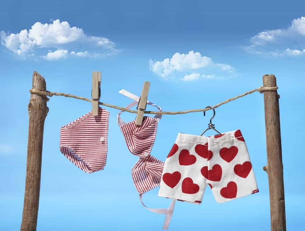 Pairs of underwear hanging to dry.