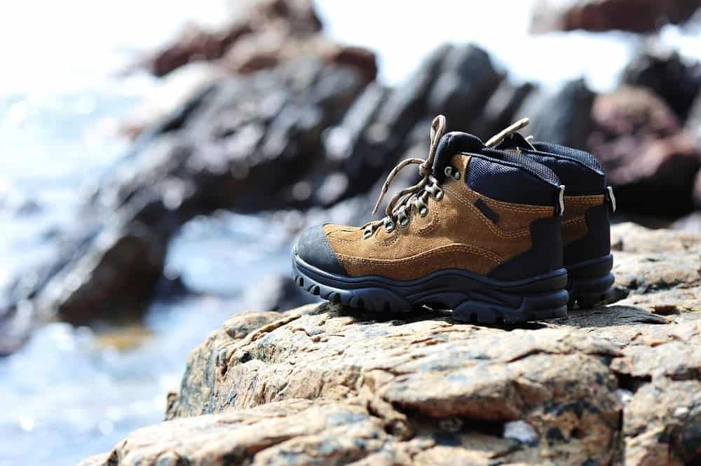 A pair of new hiking boots on a rock ledge.